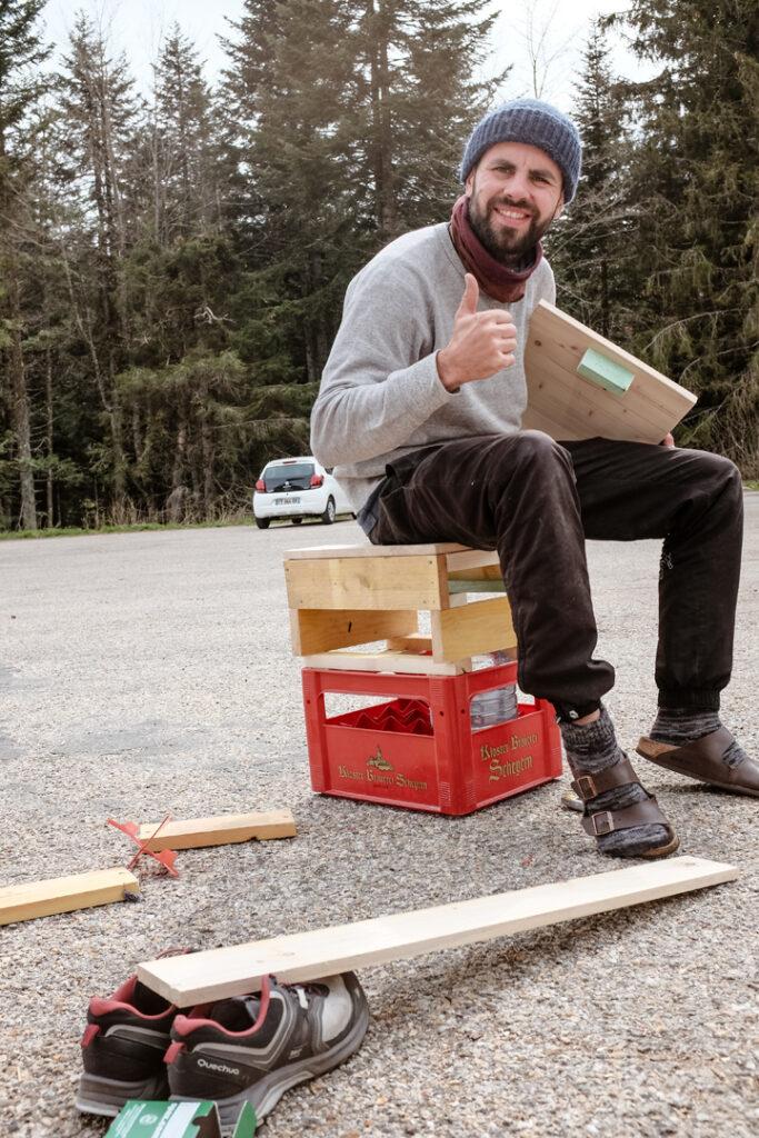 man sitting on improvised diy chair